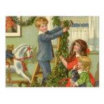 Navidad del vintage, niños del Victorian que Postal