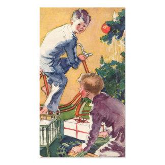 Navidad del vintage, niños del vintage con los tarjetas de visita