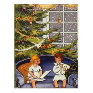 Navidad del vintage, niños que se sientan en un tarjeta postal