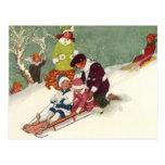 Navidad del vintage, niños Sledding en la nieve Tarjetas Postales