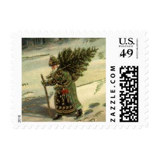 Navidad del vintage, Papá Noel que lleva un árbol Franqueo