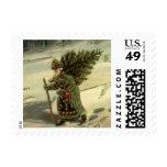 Navidad del vintage, Papá Noel que lleva un árbol Sellos Postales