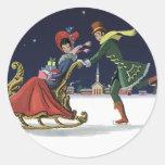Navidad del vintage, pares en el patinaje de hielo pegatina redonda