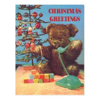 Navidad del vintage, peluche en el teléfono postales