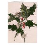 Navidad del vintage, planta del acebo con las tarjeta de felicitación