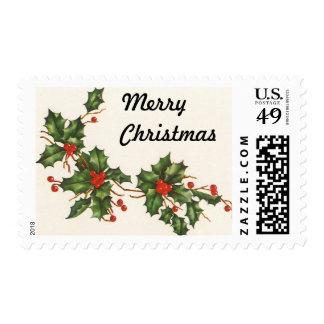 Navidad del vintage, planta del acebo con las timbre postal