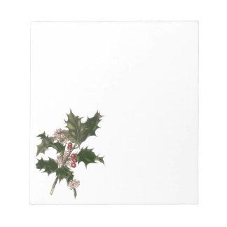 Navidad del vintage, planta verde del acebo con bloc