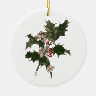 Navidad del vintage, planta verde del acebo con adorno redondo de cerámica