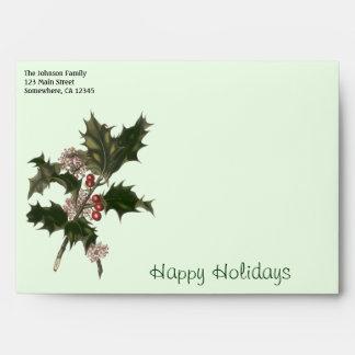 Navidad del vintage, planta verde del acebo con sobres