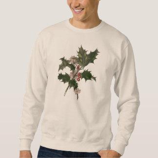 Navidad del vintage, planta verde del acebo con sudadera