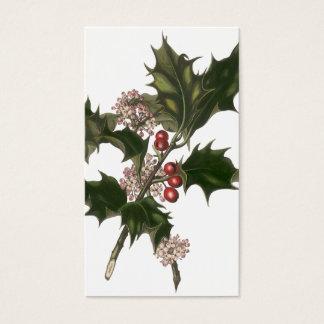 Navidad del vintage, planta verde del acebo con tarjeta de negocios