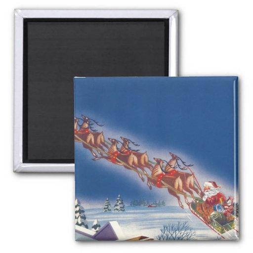 Navidad del vintage, reno del trineo del vuelo de  iman de frigorífico
