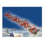 Navidad del vintage, reno del trineo del vuelo de tarjetas postales