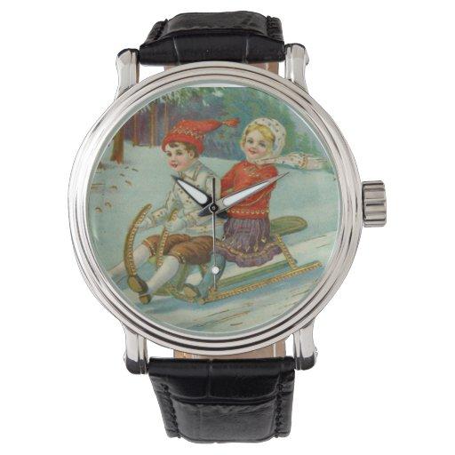 Navidad del vintage Sledding con los niños Relojes