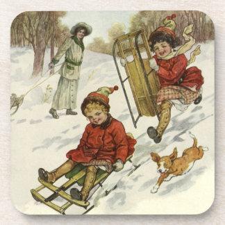 Navidad del vintage, trineo de los niños del posavasos de bebidas