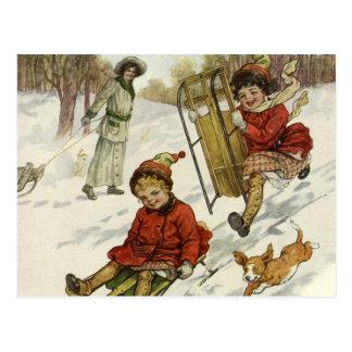 Navidad del vintage, trineo de los niños del postales