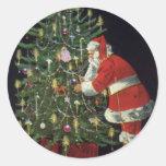 Navidad del vintage, velas del Lit de Papá Noel en Pegatinas Redondas