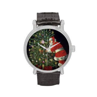 Navidad del vintage, velas del Lit de Papá Noel en Relojes