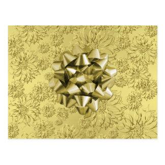 Navidad floral de oro de la hoja que envuelve con postal