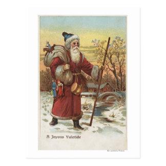 Navidad GreetingSanta con el bastón Tarjeta Postal