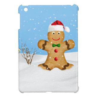 Navidad, hombre de pan de jengibre feliz en nieve
