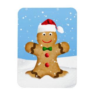 Navidad, hombre de pan de jengibre feliz en nieve imán