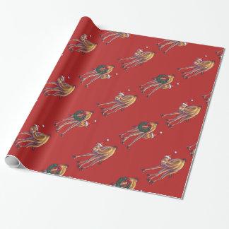 Navidad lindo del camello en rojo papel de regalo