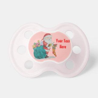 Navidad lindo del padre con los juguetes y los chupete