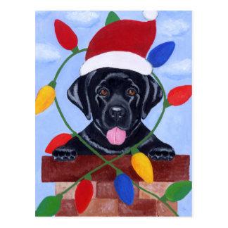 Navidad negro del perrito de Labrador