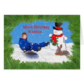 Navidad, nieto, muchacho en el trineo, muñeco de n