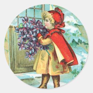 Navidad niña y violetas del vintage pegatina redonda
