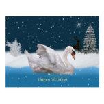 Navidad, noche Nevado con un cisne en un lago Postales