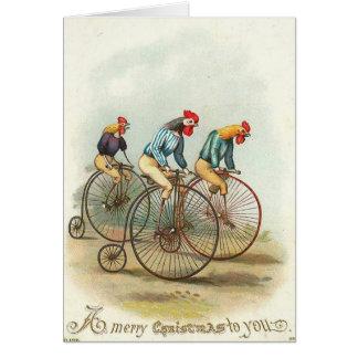 Navidad - pollos que montan Penique-Cominos Felicitación