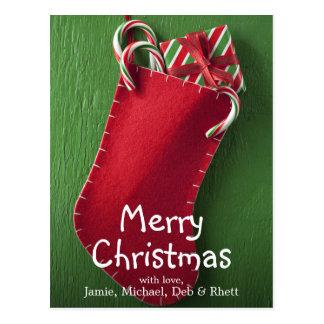 Navidad que almacena con los bastones del regalo y postales
