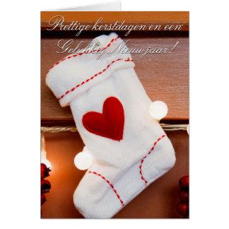 Navidad que almacena la tarjeta de felicitación