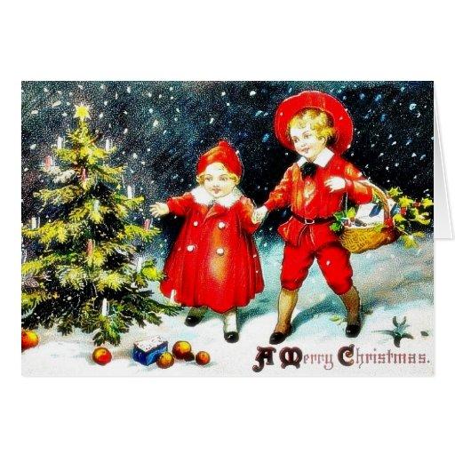 Navidad que saluda con campanas y un chica en una  tarjetas