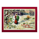 Navidad que saluda con con el christm que lleva de felicitación