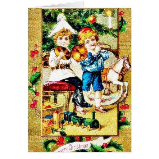 Navidad que saluda con dos muchachos que juegan ju tarjeta