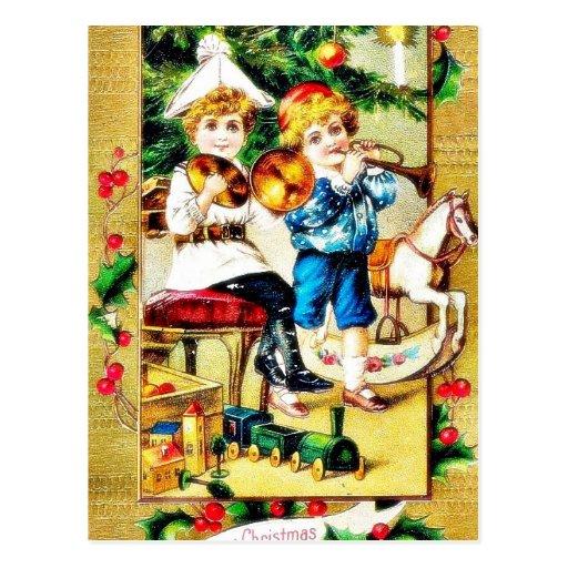 Navidad que saluda con dos muchachos que juegan ju tarjetas postales