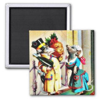 Navidad que saluda con dos ratones que llevan el d iman de nevera