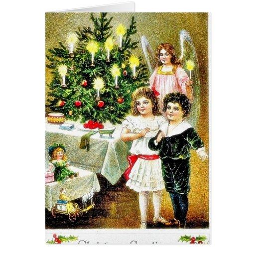 Navidad que saluda con dos rogaciones y ángeles de tarjetón