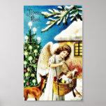 Navidad que saluda con el ángel que sostiene la ce impresiones