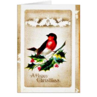 Navidad que saluda con el pájaro que se sienta en  tarjeta