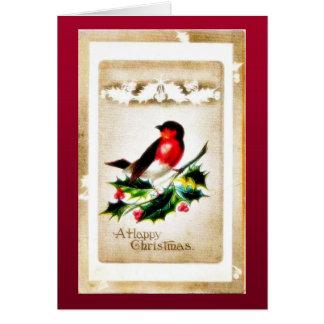 Navidad que saluda con el pájaro que se sienta en  tarjetón