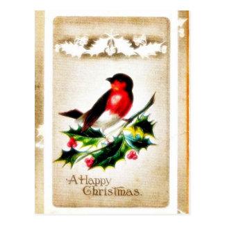Navidad que saluda con el pájaro que se sienta en  tarjeta postal