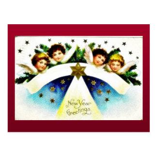 Navidad que saluda con el pájaro que se sienta en  postal