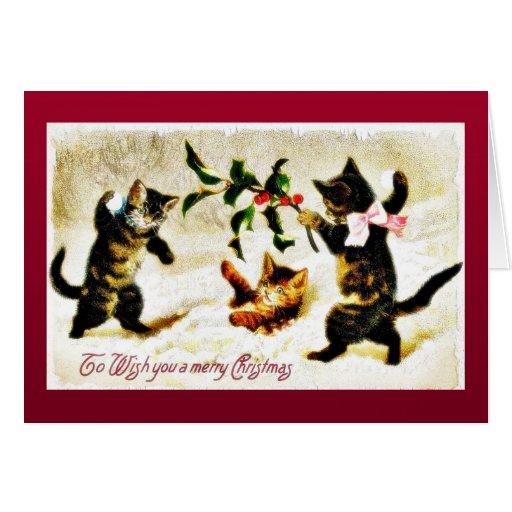 Navidad que saluda con jugar de tres gatos felicitación