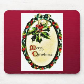 Navidad que saluda con la guirnalda alrededor tapete de raton