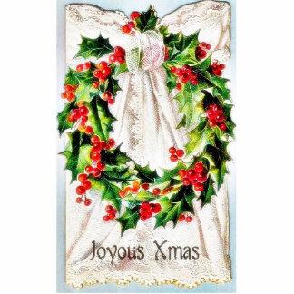 Navidad que saluda con la guirnalda atada en un pa esculturas fotograficas