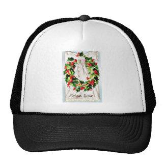 Navidad que saluda con la guirnalda atada en un pa gorra